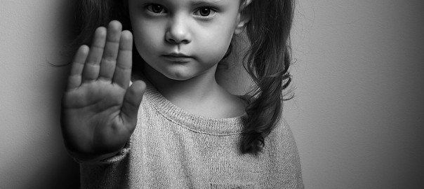 Stop Violence Against Kids. Serious Kid Showing Hand Stop Sign.
